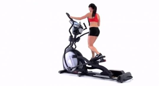 Workout in winter with elliptical machine